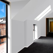 Skylights bring additional light to the upstairs spaces.