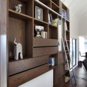 Niches and shelves create a sculptural and functional bookcase, furniture, interior design, shelf, shelving, black, gray
