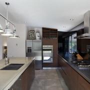 This kitchen in a renovated mountain home was countertop, cuisine classique, interior design, kitchen, real estate, gray, black