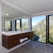 This reinvented master bathroom has floor-to-ceiling windows to estate, home, house, interior design, property, real estate, window, gray