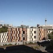 Carlaw Park Student Village in Auckland accommodates students architecture, building, city, cityscape, daytime, downtown, landmark, metropolis, metropolitan area, neighbourhood, residential area, roof, sky, skyline, skyscraper, tower block, tree, urban area, teal, black