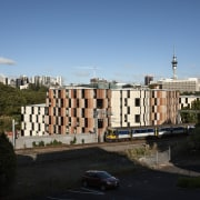 Carlaw Park Student Village in Auckland accommodates students architecture, building, city, daytime, estate, facade, house, landmark, metropolis, metropolitan area, neighbourhood, plant, real estate, residential area, roof, sky, skyline, suburb, tower block, town, tree, urban area, black, teal