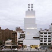 New Museum in New York City has created architecture, building, city, condominium, corporate headquarters, daytime, metropolis, metropolitan area, mixed use, skyscraper, tower, tower block, urban area, white