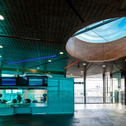 A substantial, timber-clad gullwing roof appears to float architecture, ceiling, daylighting, interior design, leisure centre, lobby, teal, black