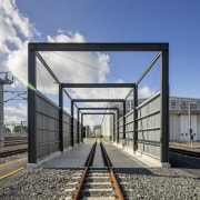 A purpose-built wash platform is one of several architecture, facade, residential area, sky, track, train station, transport, teal, gray