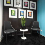 This 20m wall in the new Auckland office chair, floor, furniture, interior design, office, product design, table, wall, black