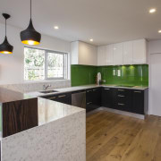 The green glass splashback and Silestone benchtops form cabinetry, countertop, floor, interior design, kitchen, property, real estate, room, gray