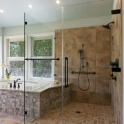 The shower in this remodeled bathroom is now bathroom, countertop, floor, flooring, home, interior design, plumbing fixture, room, tile, wall, gray, brown