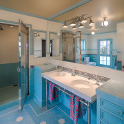 A double Ikea sink sits on a custom bathroom, home, interior design, real estate, room, gray, teal