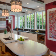 The long island in this kitchen runs parallel countertop, dining room, home, interior design, kitchen, room, table, window, gray, brown