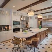 At one end of this island, a lowered cabinetry, ceiling, countertop, cuisine classique, interior design, kitchen, real estate, room, gray