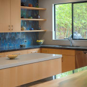 The kitchen features two parallel islands, one for cabinetry, countertop, daylighting, interior design, kitchen, room, table, window, wood, gray