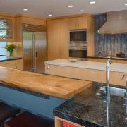 To counter the strong linear look of the cabinetry, countertop, flooring, hardwood, interior design, kitchen, real estate, room, wood