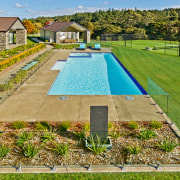 New home with pool house and gymnasium by estate, grass, lawn, leisure, property, real estate, swimming pool, brown