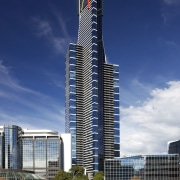 The Eureka Tower in  Melbourne overlooks the architecture, building, city, cityscape, commercial building, condominium, corporate headquarters, daytime, headquarters, landmark, metropolis, metropolitan area, mixed use, reflection, sky, skyline, skyscraper, tower, tower block, urban area, water, blue