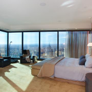 The master suite in the penthouse apartment in bedroom, ceiling, estate, floor, interior design, penthouse apartment, property, real estate, room, suite, window, gray