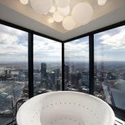 A circular Kos Geo bathtub takes prime position architecture, bathroom, bathtub, ceiling, daylighting, home, interior design, sky, window, white, gray