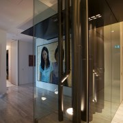 Mechanical services encased in glass create a sculptural ceiling, floor, flooring, glass, interior design, lighting, lobby, wall, brown