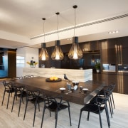 Black brushed steel cabinets define the front-of-house kitchen dining room, interior design, kitchen, table, gray