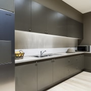 The walk-in butlers pantry has plenty of storage cabinetry, countertop, cuisine classique, interior design, kitchen, product design, black, gray