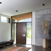 The entry to this mountain home  by architecture, ceiling, daylighting, floor, flooring, house, interior design, lobby, wood, wood flooring, gray