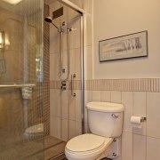 Mosaic tiles reduce the risk of slipping in bathroom, floor, interior design, plumbing fixture, room, orange, brown