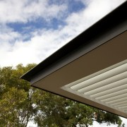 Cantilevered awning on contemporary home - Cantilevered awning architecture, cloud, daylighting, daytime, facade, home, house, residential area, roof, siding, sky, sunlight, tree, brown, gray