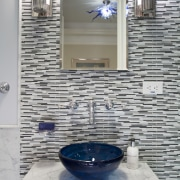 This bathroom has Art Deco tapware, a freestanding bathroom, floor, flooring, glass, interior design, room, sink, tile, wall, gray
