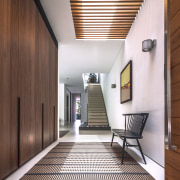 Wood panelling beside the entry conceals storage cabinets architecture, ceiling, daylighting, house, interior design, lobby, real estate, wood, brown