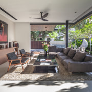 The ground-floor living room of this house designed home, house, interior design, living room, real estate, room, gray