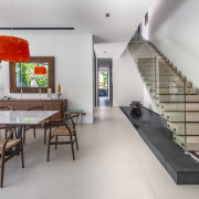 Although cast in concrete, these stairs appear as furniture, interior design, table, gray