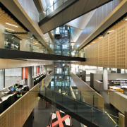 Natural light floods the large central atrium at architecture, building, daylighting, institution, interior design, lobby, black