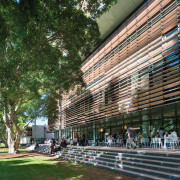 Communal area near entry to Tyree Energy Technologies architecture, building, city, landmark, metropolitan area, mixed use, plaza, structure, tree, urban area, brown