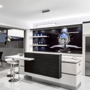 Large sliding doors open up this kitchen to countertop, home appliance, interior design, kitchen, product design, white