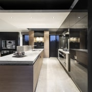 An appliance cabinet at the end of this countertop, cuisine classique, interior design, kitchen, white, black
