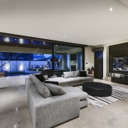In this new home, sliding doors can be ceiling, estate, floor, home, interior design, living room, property, real estate, room, gray