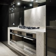 The black lacquered cabinets in this kitchen contain interior design, gray, black