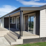 Clad in low-maintenance cedar and aluminium cladding, the facade, home, house, property, real estate, siding, window, white
