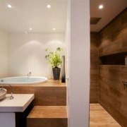 This master bathroom by Leonie von Sturmer features architecture, bathroom, ceiling, countertop, floor, home, interior design, property, real estate, room, sink, gray, brown