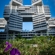 Because the buildings in The Interlace apartment development architecture, building, city, commercial building, condominium, corporate headquarters, daytime, facade, landmark, metropolis, metropolitan area, mixed use, plant, real estate, residential area, sky, skyscraper, tower block, urban area