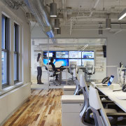In this Kimberly-Clark office in Chicago, mobile cabinets structure, technology, gray