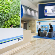 This reception area with green wall, customer seating floor, flooring, interior design, product design, gray