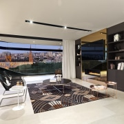 This open-plan contemporary living space in a Sydney interior design, kitchen, gray, black