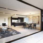 This open-plan living area includes the apartment's kitchen, apartment, ceiling, house, interior design, living room, penthouse apartment, property, real estate, room, gray