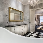 Chandeliers reinforce the glamour of this master suite bathroom, floor, flooring, home, interior design, real estate, room, wall, gray