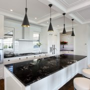 The island bench top features a single slab countertop, interior design, kitchen, room, gray