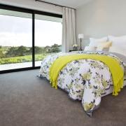 Bedroom in large modern country home - Bedroom bed, bed frame, bed sheet, bedroom, floor, flooring, home, house, interior design, mattress, property, real estate, room, gray
