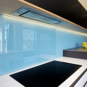 Modern kitchen with Fisher & Paykel induction cooktop architecture, countertop, daylighting, glass, house, interior design, lighting, product design, black, teal, white