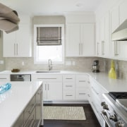 Putty-colored subway tiles with a crackle glaze offer countertop, interior design, kitchen, real estate, room, white