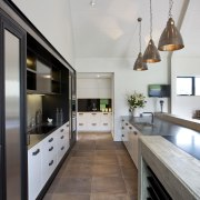 This kitchen provides a galley work space, with countertop, cuisine classique, interior design, kitchen, real estate, gray